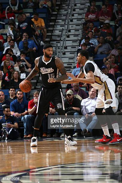 DeMarcus Cousins of the Sacramento Kings handles the ball against Anthony Davis of the New Orleans Pelicans on March 7 2016 at the Smoothie King...