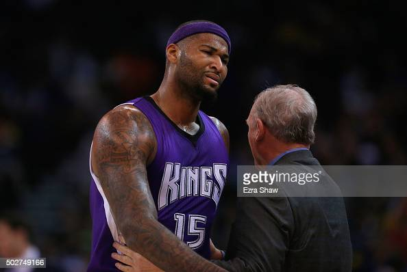 DeMarcus Cousins of the Sacramento Kings is consoled by George Karl of the Sacramento Kings after being taken out of the game after he picked up his...
