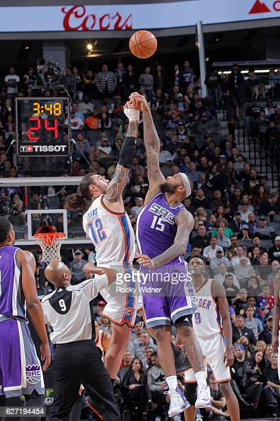 DeMarcus Cousins of the Sacramento Kings jumps for the ball against Steven Adams of the Oklahoma City Thunder on November 23 2016 at Golden 1 Center...