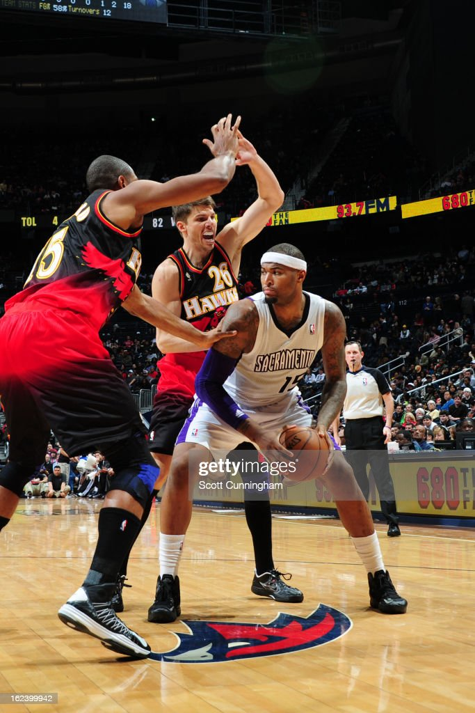 <a gi-track='captionPersonalityLinkClicked' href=/galleries/search?phrase=DeMarcus+Cousins&family=editorial&specificpeople=5792008 ng-click='$event.stopPropagation()'>DeMarcus Cousins</a> #15 of the Sacramento Kings looks to pass the ball against <a gi-track='captionPersonalityLinkClicked' href=/galleries/search?phrase=Al+Horford&family=editorial&specificpeople=699030 ng-click='$event.stopPropagation()'>Al Horford</a> #15 and <a gi-track='captionPersonalityLinkClicked' href=/galleries/search?phrase=Kyle+Korver&family=editorial&specificpeople=202504 ng-click='$event.stopPropagation()'>Kyle Korver</a> #26 of the Atlanta Hawks on February 22, 2013 at Philips Arena in Atlanta, Georgia.