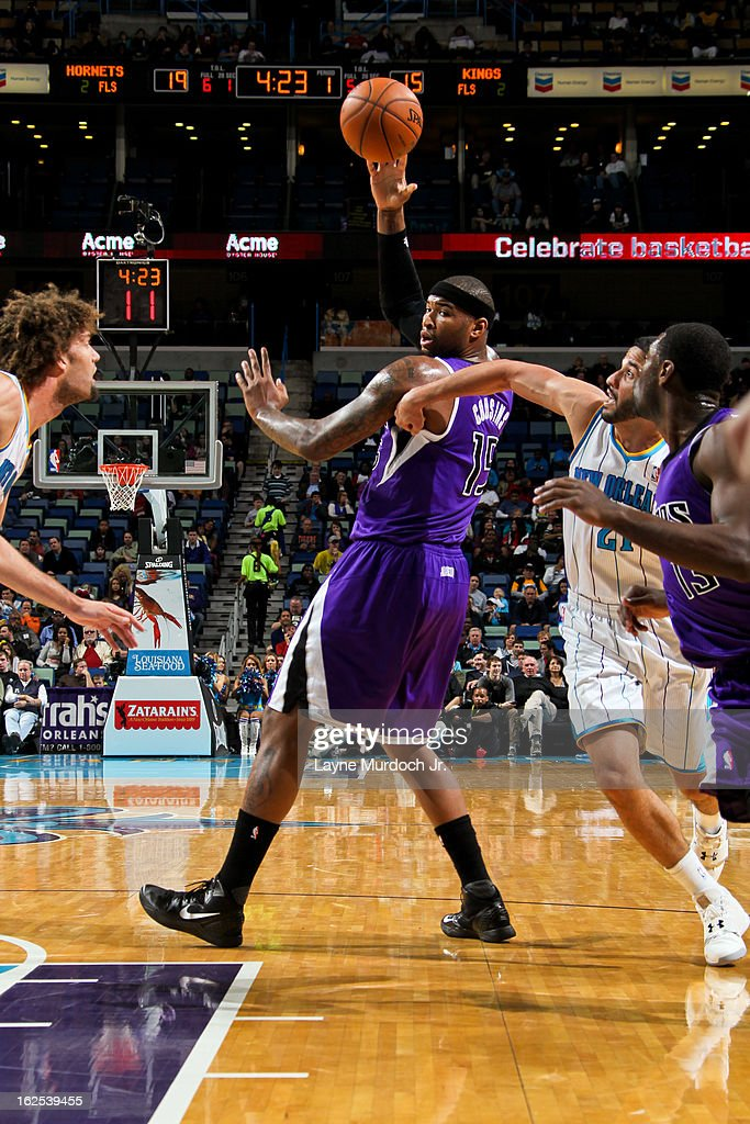 DeMarcus Cousins #15 of the Sacramento Kings passes the ball against Greivis Vasquez #21 of the New Orleans Hornets on February 24, 2013 at the New Orleans Arena in New Orleans, Louisiana.