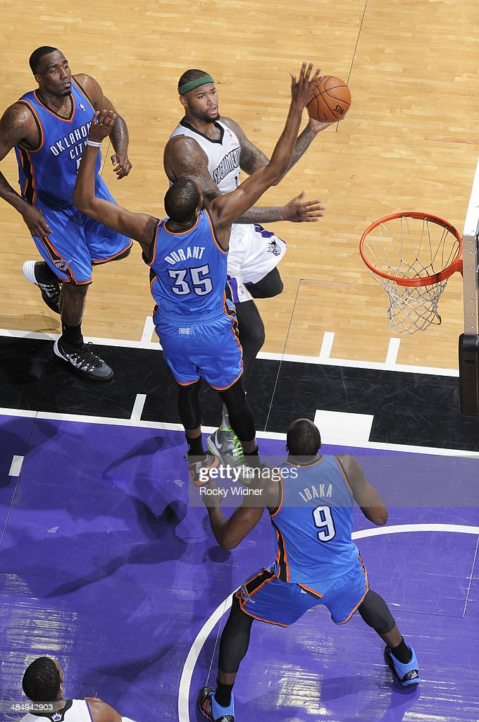 <a gi-track='captionPersonalityLinkClicked' href=/galleries/search?phrase=DeMarcus+Cousins&family=editorial&specificpeople=5792008 ng-click='$event.stopPropagation()'>DeMarcus Cousins</a> #15 of the Sacramento Kings puts up a shot against <a gi-track='captionPersonalityLinkClicked' href=/galleries/search?phrase=Kevin+Durant&family=editorial&specificpeople=3847329 ng-click='$event.stopPropagation()'>Kevin Durant</a> #35 of the Oklahoma City Thunder on April 8, 2014 at Sleep Train Arena in Sacramento, California.