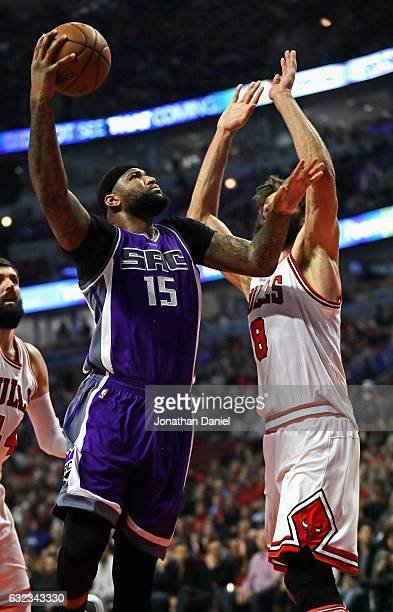 DeMarcus Cousins of the Sacramento Kings puts up a shot against Robin Lopez of the Chicago Bulls at the United Center on January 21 2017 in Chicago...