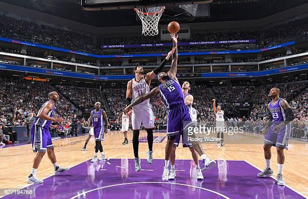 DeMarcus Cousins of the Sacramento Kings rebounds against Enes Kanter of the Oklahoma City Thunder on November 23 2016 at Golden 1 Center in...