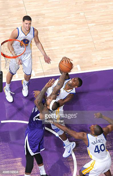 DeMarcus Cousins of the Sacramento Kings rebounds against Festus Ezeli of the Golden State Warriors on October 29 2014 at Sleep Train Arena in...