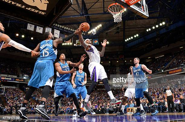 DeMarcus Cousins of the Sacramento Kings rebounds against Shabazz Muhammad of the Minnesota Timberwolves on March 1 2014 at Sleep Train Arena in...
