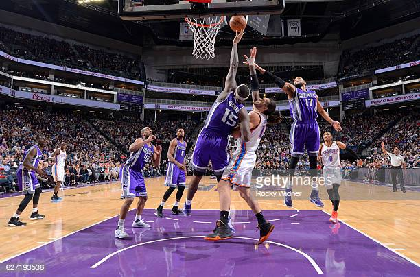 DeMarcus Cousins of the Sacramento Kings rebounds against Steven Adams of the Oklahoma City Thunder on November 23 2016 at Golden 1 Center in...