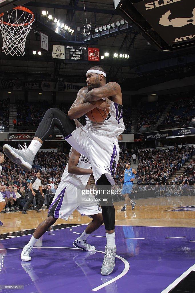 DeMarcus Cousins #15 of the Sacramento Kings rebounds the ball against the Dallas Mavericks on January 10, 2013 at Sleep Train Arena in Sacramento, California.