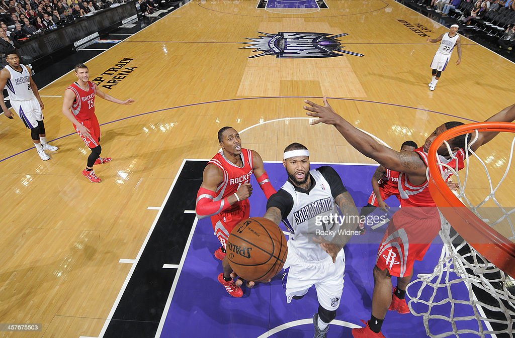 <a gi-track='captionPersonalityLinkClicked' href=/galleries/search?phrase=DeMarcus+Cousins&family=editorial&specificpeople=5792008 ng-click='$event.stopPropagation()'>DeMarcus Cousins</a> #15 of the Sacramento Kings shoots a layup against Terrence Jones #6 of the Houston Rockets on December 15, 2013 at Sleep Train Arena in Sacramento, California.