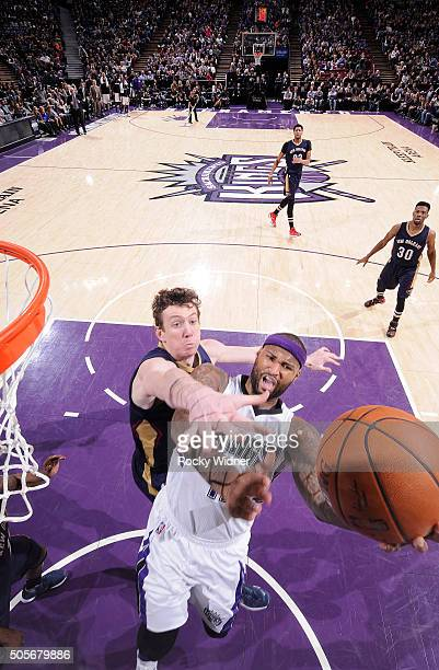 DeMarcus Cousins of the Sacramento Kings shoots a layup against Omer Asik of the New Orleans Pelicans on January 13 2016 at Sleep Train Arena in...