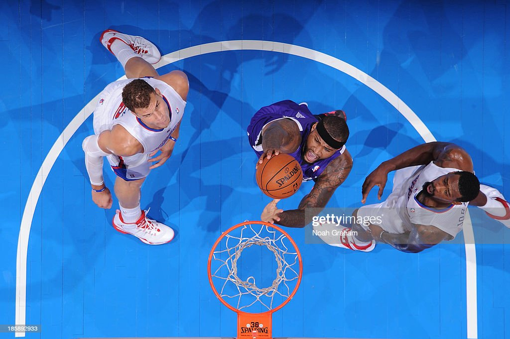 <a gi-track='captionPersonalityLinkClicked' href=/galleries/search?phrase=DeMarcus+Cousins&family=editorial&specificpeople=5792008 ng-click='$event.stopPropagation()'>DeMarcus Cousins</a> #15 of the Sacramento Kings shoots against <a gi-track='captionPersonalityLinkClicked' href=/galleries/search?phrase=Blake+Griffin+-+Basketball+Player&family=editorial&specificpeople=4216010 ng-click='$event.stopPropagation()'>Blake Griffin</a> #32 and <a gi-track='captionPersonalityLinkClicked' href=/galleries/search?phrase=DeAndre+Jordan&family=editorial&specificpeople=4665718 ng-click='$event.stopPropagation()'>DeAndre Jordan</a> #6 of the Los Angeles Clippers at Staples Center on October 25, 2013 in Los Angeles, California.
