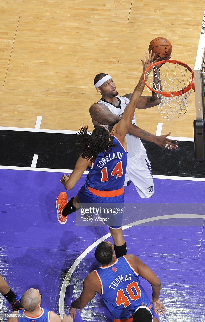 <a gi-track='captionPersonalityLinkClicked' href=/galleries/search?phrase=DeMarcus+Cousins&family=editorial&specificpeople=5792008 ng-click='$event.stopPropagation()'>DeMarcus Cousins</a> #15 of the Sacramento Kings shoots against <a gi-track='captionPersonalityLinkClicked' href=/galleries/search?phrase=Chris+Copeland&family=editorial&specificpeople=833969 ng-click='$event.stopPropagation()'>Chris Copeland</a> #14 of the New York Knicks on December 28, 2012 at Sleep Train Arena in Sacramento, California.