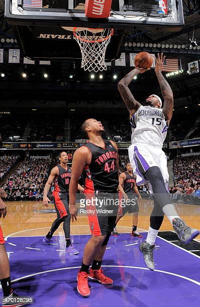 DeMarcus Cousins of the Sacramento Kings shoots against Chuck Hayes of the Toronto Raptors on February 5 2014 at Sleep Train Arena in Sacramento...