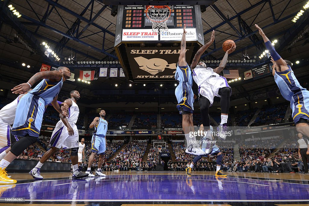 <a gi-track='captionPersonalityLinkClicked' href=/galleries/search?phrase=DeMarcus+Cousins&family=editorial&specificpeople=5792008 ng-click='$event.stopPropagation()'>DeMarcus Cousins</a> #15 of the Sacramento Kings shoots against <a gi-track='captionPersonalityLinkClicked' href=/galleries/search?phrase=Darrell+Arthur&family=editorial&specificpeople=4102032 ng-click='$event.stopPropagation()'>Darrell Arthur</a> #00 of the Memphis Grizzlies on January 7, 2013 at Sleep Train Arena in Sacramento, California.