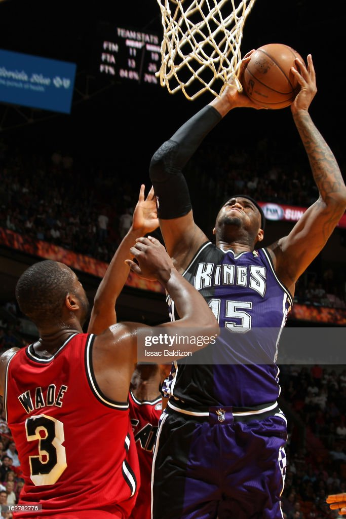 <a gi-track='captionPersonalityLinkClicked' href=/galleries/search?phrase=DeMarcus+Cousins&family=editorial&specificpeople=5792008 ng-click='$event.stopPropagation()'>DeMarcus Cousins</a> #15 of the Sacramento Kings shoots against <a gi-track='captionPersonalityLinkClicked' href=/galleries/search?phrase=Dwyane+Wade&family=editorial&specificpeople=201481 ng-click='$event.stopPropagation()'>Dwyane Wade</a> #3 of the Miami Heat on February 26, 2013 at American Airlines Arena in Miami, Florida.
