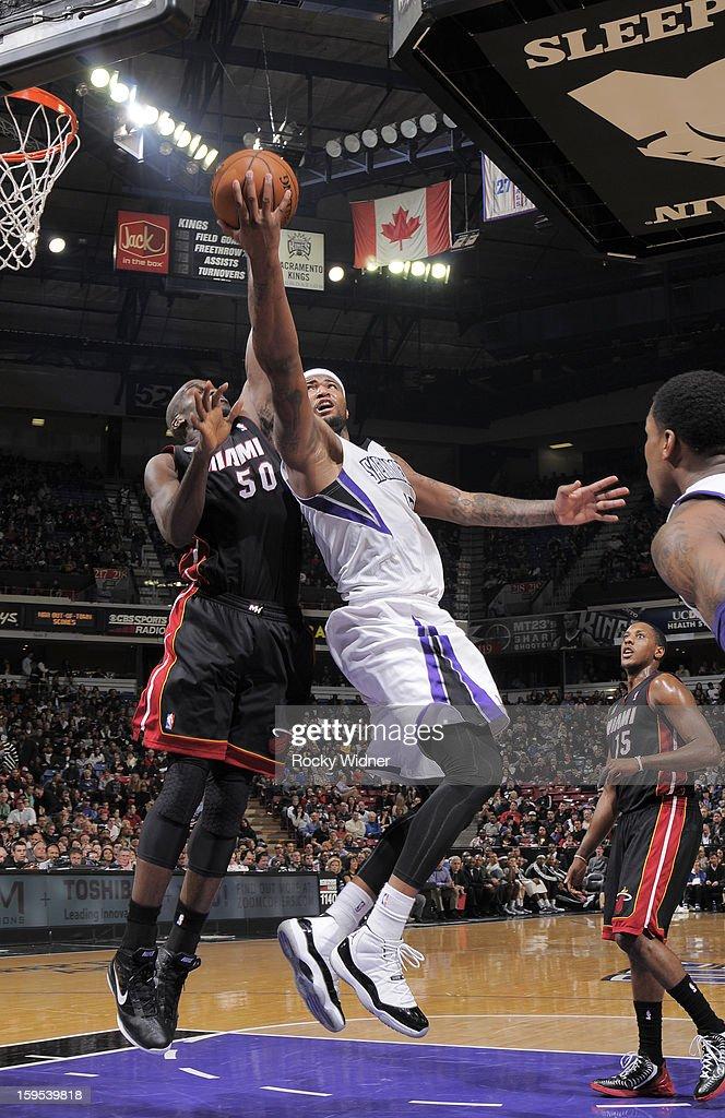 DeMarcus Cousins #15 of the Sacramento Kings shoots against Joel Anthony #50 of the Miami Heat on January 12, 2013 at Sleep Train Arena in Sacramento, California.