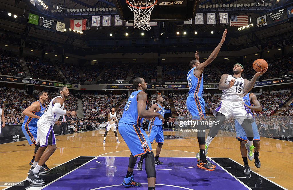 <a gi-track='captionPersonalityLinkClicked' href=/galleries/search?phrase=DeMarcus+Cousins&family=editorial&specificpeople=5792008 ng-click='$event.stopPropagation()'>DeMarcus Cousins</a> #15 of the Sacramento Kings shoots against <a gi-track='captionPersonalityLinkClicked' href=/galleries/search?phrase=Kevin+Durant&family=editorial&specificpeople=3847329 ng-click='$event.stopPropagation()'>Kevin Durant</a> #35 of the Oklahoma City Thunder on April 8, 2014 at Sleep Train Arena in Sacramento, California.