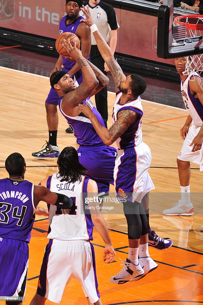 DeMarcus Cousins #15 of the Sacramento Kings shoots against Markieff Morris #11 of the Phoenix Suns on March 28, 2013 at U.S. Airways Center in Phoenix, Arizona.
