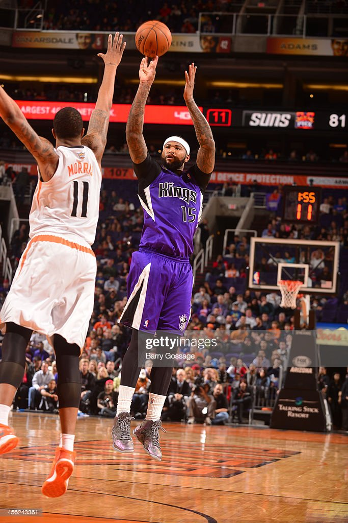<a gi-track='captionPersonalityLinkClicked' href=/galleries/search?phrase=DeMarcus+Cousins&family=editorial&specificpeople=5792008 ng-click='$event.stopPropagation()'>DeMarcus Cousins</a> #15 of the Sacramento Kings shoots against <a gi-track='captionPersonalityLinkClicked' href=/galleries/search?phrase=Markieff+Morris&family=editorial&specificpeople=5293881 ng-click='$event.stopPropagation()'>Markieff Morris</a> #11 of the Phoenix Suns on December 13, 2013 at U.S. Airways Center in Phoenix, Arizona.