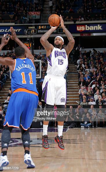DeMarcus Cousins of the Sacramento Kings shoots against Samuel Dalembert of the New York Knicks on December 27 2014 at Sleep Train Arena in...