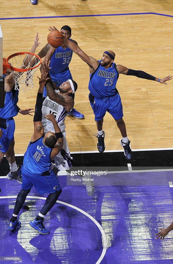 <a gi-track='captionPersonalityLinkClicked' href=/galleries/search?phrase=DeMarcus+Cousins&family=editorial&specificpeople=5792008 ng-click='$event.stopPropagation()'>DeMarcus Cousins</a> #15 of the Sacramento Kings shoots against <a gi-track='captionPersonalityLinkClicked' href=/galleries/search?phrase=Shawn+Marion&family=editorial&specificpeople=201566 ng-click='$event.stopPropagation()'>Shawn Marion</a> #0 and <a gi-track='captionPersonalityLinkClicked' href=/galleries/search?phrase=Vince+Carter&family=editorial&specificpeople=201488 ng-click='$event.stopPropagation()'>Vince Carter</a> #25 of the Dallas Mavericks on January 10, 2013 at Sleep Train Arena in Sacramento, California.