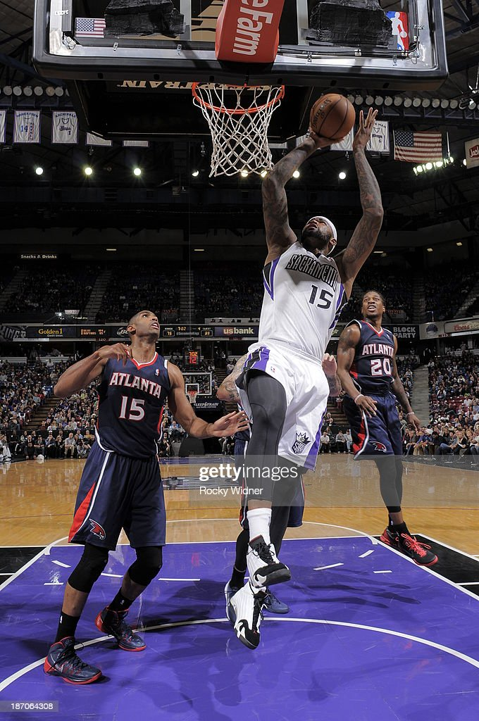 DeMarcus Cousins #15 of the Sacramento Kings shoots the ball against Al Horford #15 of the Atlanta Hawks at Sleep Train Arena on November 5, 2013 in Sacramento, California.