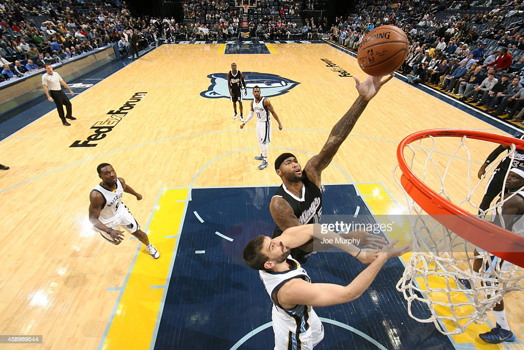 DeMarcus Cousins of the Sacramento Kings shoots the ball against Marc Gasol of the Memphis Grizzlies on November 13 2014 at FedExForum in Memphis...