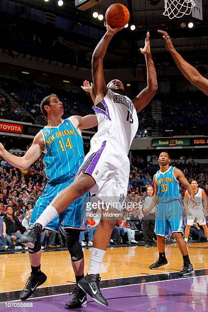 DeMarcus Cousins of the Sacramento Kings shoots the ball against Jason Smith of the New Orleans Hornets on November 21 2010 at ARCO Arena in...