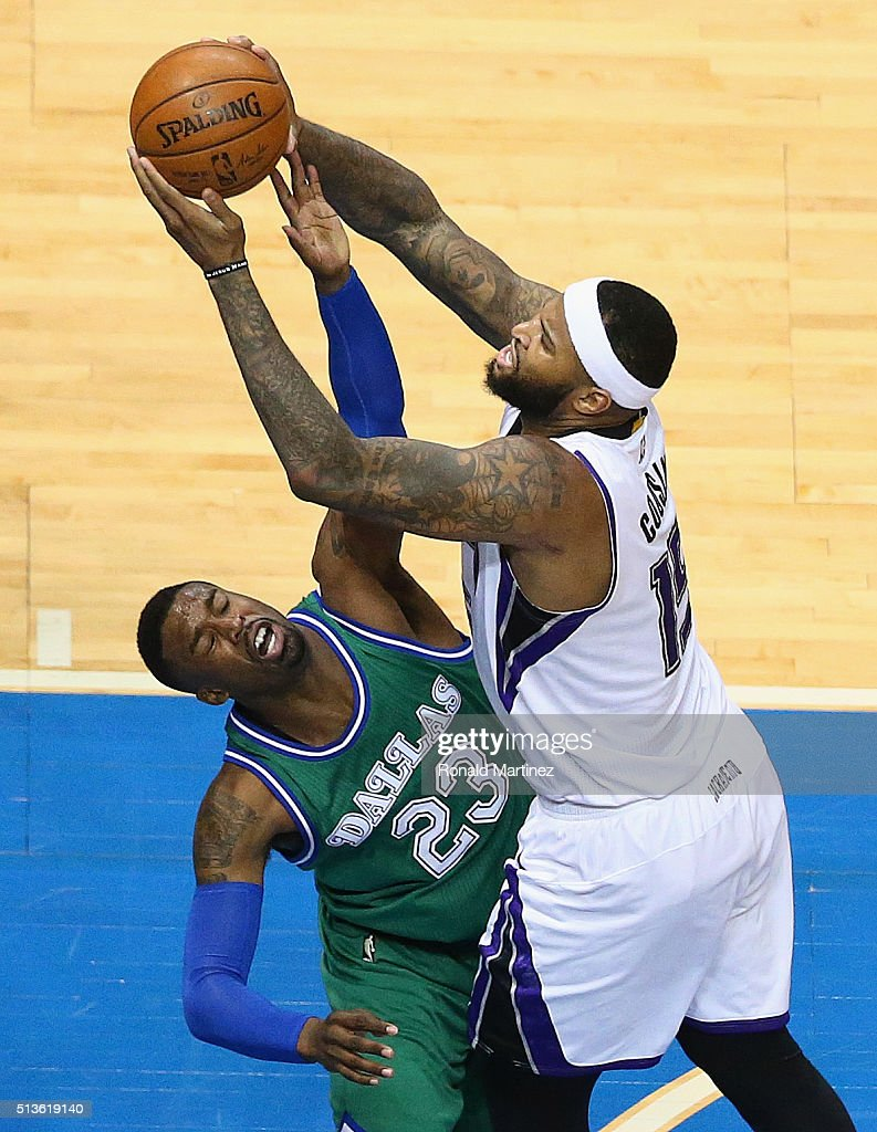 DeMarcus Cousins of the Sacramento Kings takes a shot against Wesley Matthews of the Dallas Mavericks during the second half at American Airlines...