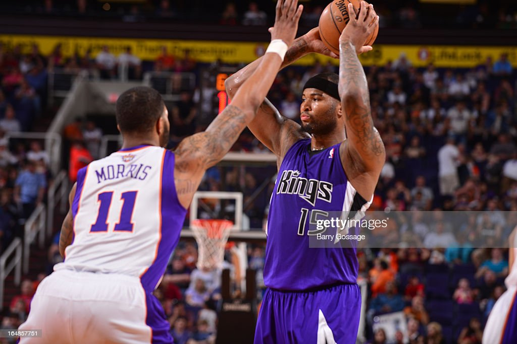 DeMarcus Cousins #15 of the Sacramento Kings tries to pass around Markieff Morris #11 of the Phoenix Suns on March 28, 2013 at U.S. Airways Center in Phoenix, Arizona.