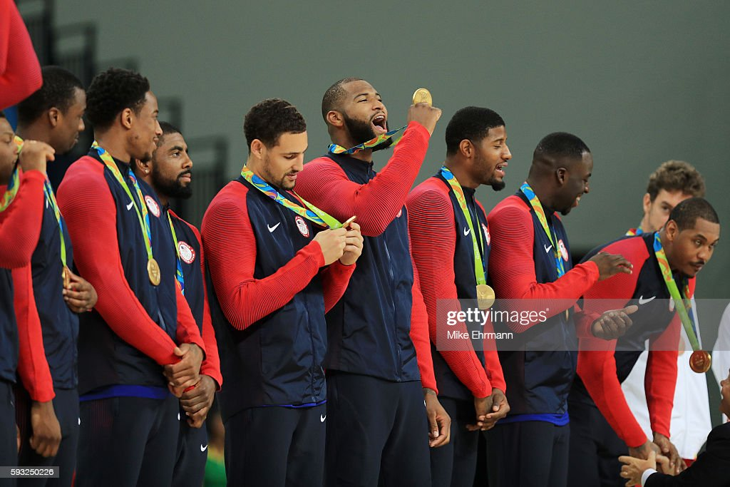 Demarcus Cousins of the United States celebrates with his gold medal on the podium after defeating Serbia in the Men's Gold medal game on Day 16 of...