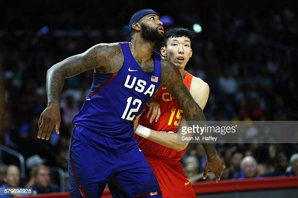 DeMarcus Cousins of the United States fights for position against Zhou Qi of China during the second half of a USA Basketball showcase exhibition...
