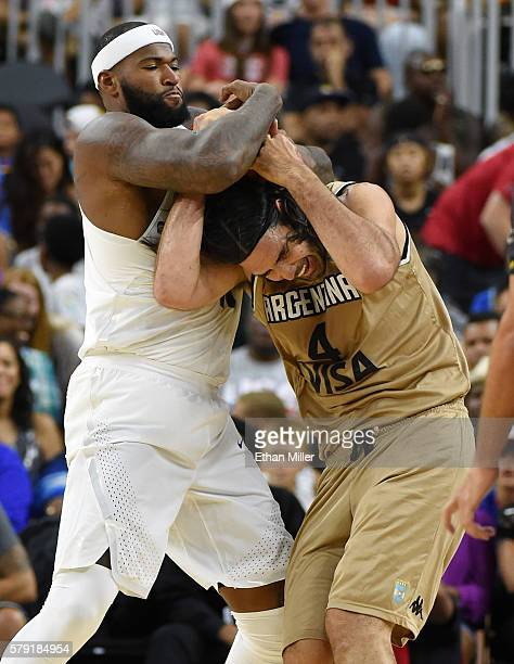 DeMarcus Cousins of the United States fouls Luis Scola of Argentina during a USA Basketball showcase exhibition game at TMobile Arena on July 22 2016...