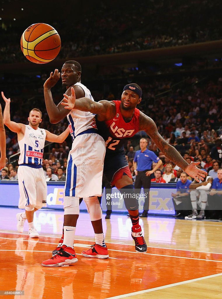 <a gi-track='captionPersonalityLinkClicked' href=/galleries/search?phrase=DeMarcus+Cousins&family=editorial&specificpeople=5792008 ng-click='$event.stopPropagation()'>DeMarcus Cousins</a> #12 of the USA and Alexander Franklin #6 of Puerto Rico battle for the ballduring their game at Madison Square Garden on August 22, 2014 in New York City.