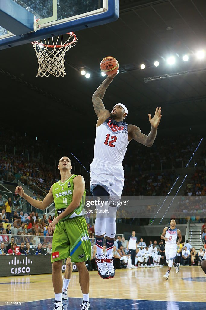 <a gi-track='captionPersonalityLinkClicked' href=/galleries/search?phrase=DeMarcus+Cousins&family=editorial&specificpeople=5792008 ng-click='$event.stopPropagation()'>DeMarcus Cousins</a> #12 of the USA Basketball Men's National Team drives to the basket against the Slovenia Basketball Men's National Team on August 26, 2014 at Gran Canaria Arena in Las Palmas, Gran Canaria, Spain.