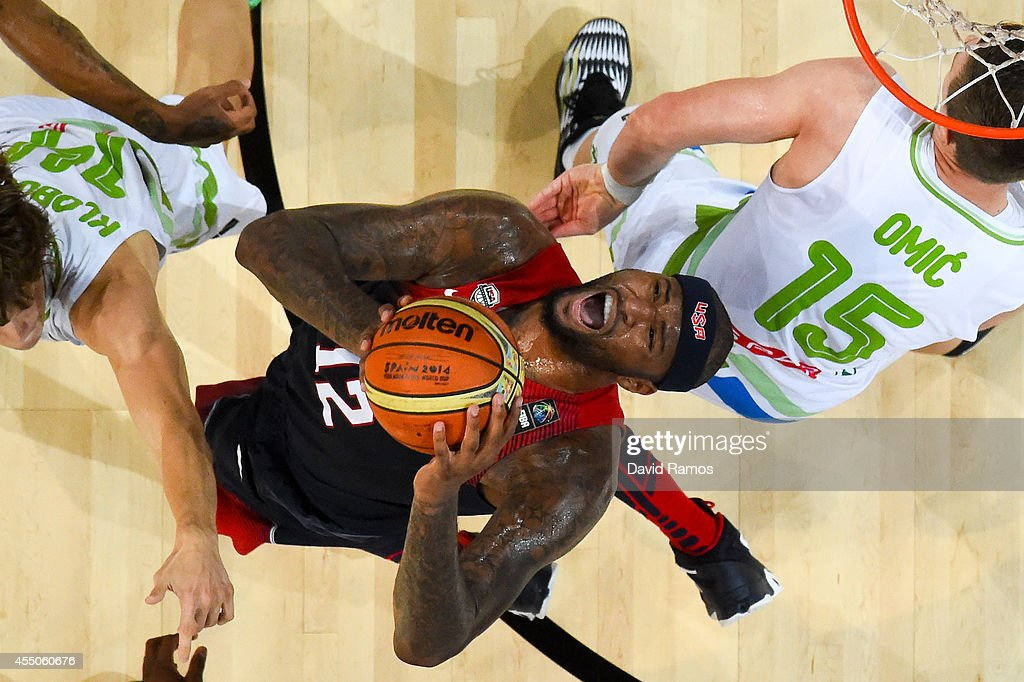 DeMarcus Cousins #12 of the USA Basketball Men's National Team duels for the ball against Slovenia Basketball Men's National Team during 2014 FIBA Basketball World Cup quarter-final match between Slovenia and USA at Palau Sant Jordi on September 9, 2014 in Barcelona, Spain.