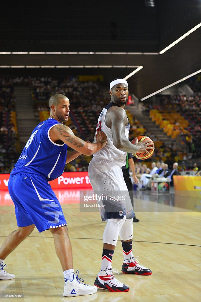 <a gi-track='captionPersonalityLinkClicked' href=/galleries/search?phrase=DeMarcus+Cousins&family=editorial&specificpeople=5792008 ng-click='$event.stopPropagation()'>DeMarcus Cousins</a> #12 of the USA Basketball Men's National Team handles the basketball against Gerald Lee #8 the Finland Nation Basketball Team during the FIBA 2014 World Cup Tournament at the Bilbao Exhibition Center on August 30, 2014 in Bilbao, Spain.