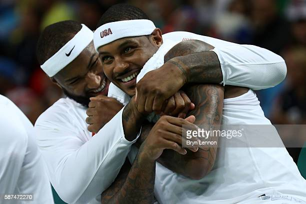 Demarcus Cousins of United States and Carmelo Anthony of United States react on the bench during the game against Venezuela in the men's preliminary...