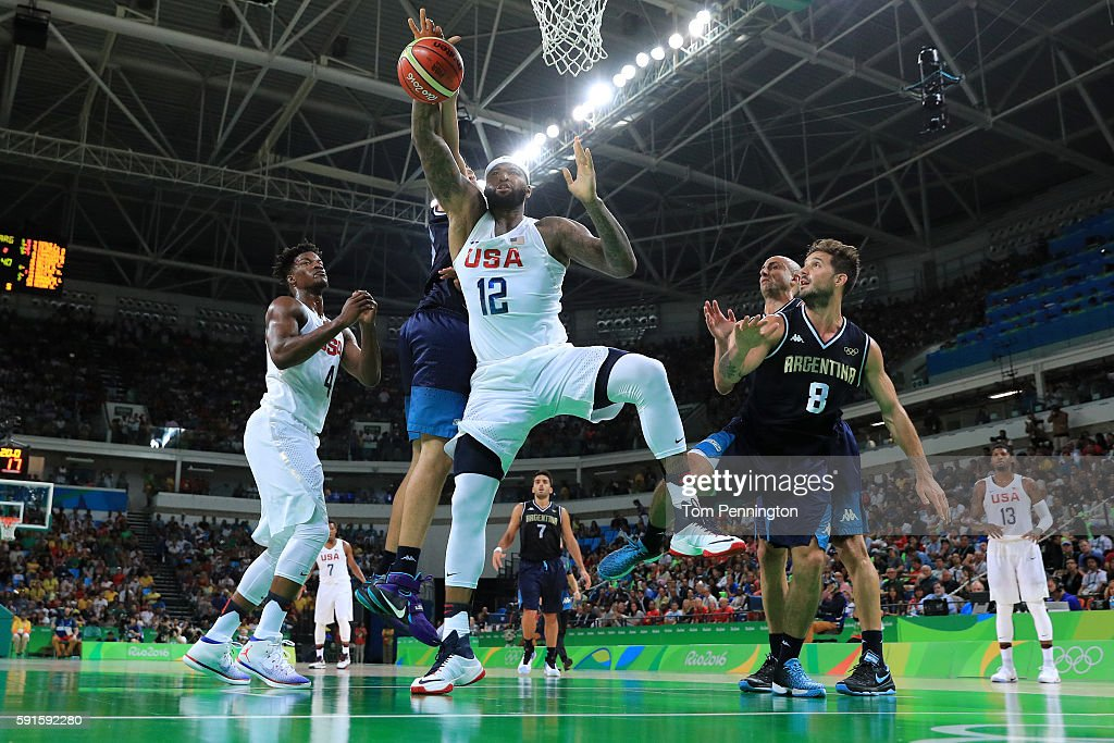 Demarcus Cousins of United States goes for the ball alongside Nicolas Laprovittola of Argentina during the Men's Basketball Quarterfinal game at...