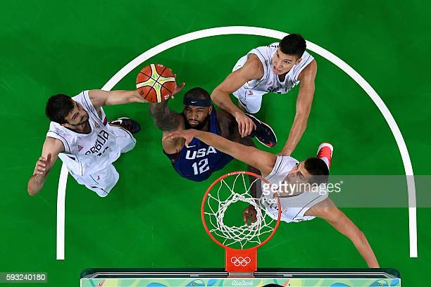 Demarcus Cousins of United States grabs a rebound against Serbia during the Men's Gold medal game on Day 16 of the Rio 2016 Olympic Games at Carioca...