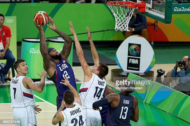 Demarcus Cousins of United States shoots the ball over Nikola Jokic of Serbia during the Men's Gold medal game on Day 16 of the Rio 2016 Olympic...