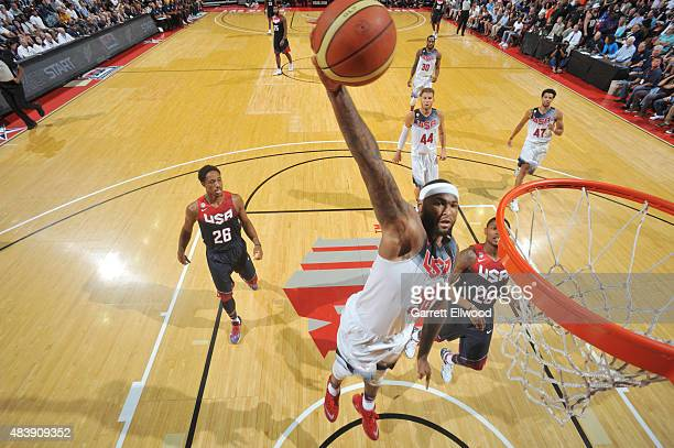 DeMarcus Cousins of USA White goes up for a dunk against USA Blue during Team USA Basketball Showcase on August 13 2015 at the Thomas Mack Center in...