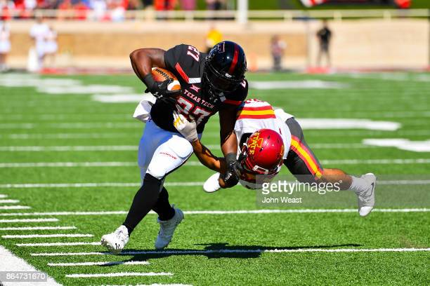 Demarcus Felton of the Texas Tech Red Raiders is tackled by Braxton Lewis of the Iowa State Cyclones during the game on October 21 2017 at Jones ATT...