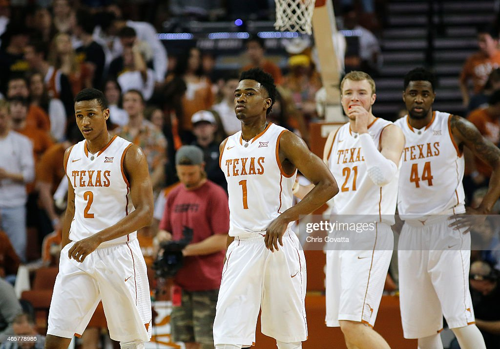 Demarcus Holland Isaiah Taylor Connor Lammert and Prince Ibeh of the Texas Longhorns walk on the court during the game with the Kansas State Wildcats...