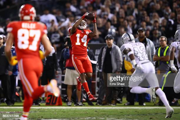Demarcus Robinson of the Kansas City Chiefs makes a 33yard catch against the Oakland Raiders during their NFL game at OaklandAlameda County Coliseum...