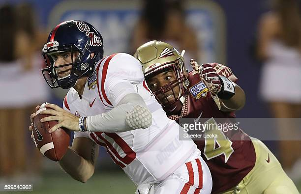 DeMarcus Walker of the Florida State Seminoles strip sacks Chad Kelly of the Mississippi Rebels in the third quarter during the Camping World Kickoff...