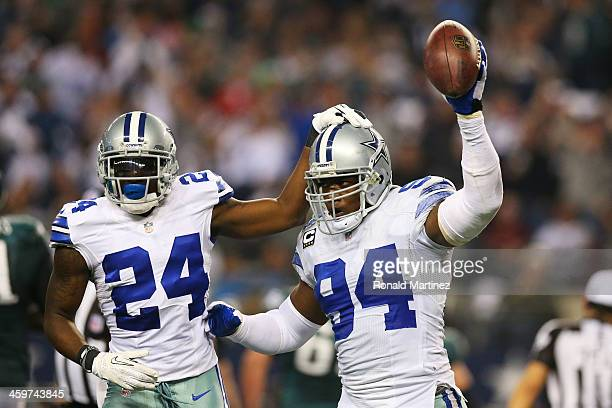 DeMarcus Ware and Morris Claiborne of the Dallas Cowboys celebrate a fumble recovery in the second half against the Philadelphia Eagles at Cowboys...