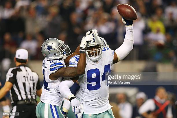 DeMarcus Ware and Morris Claiborne of the Dallas Cowboys celebrate in the second half against the Philadelphia Eagles at Cowboys Stadium on December...