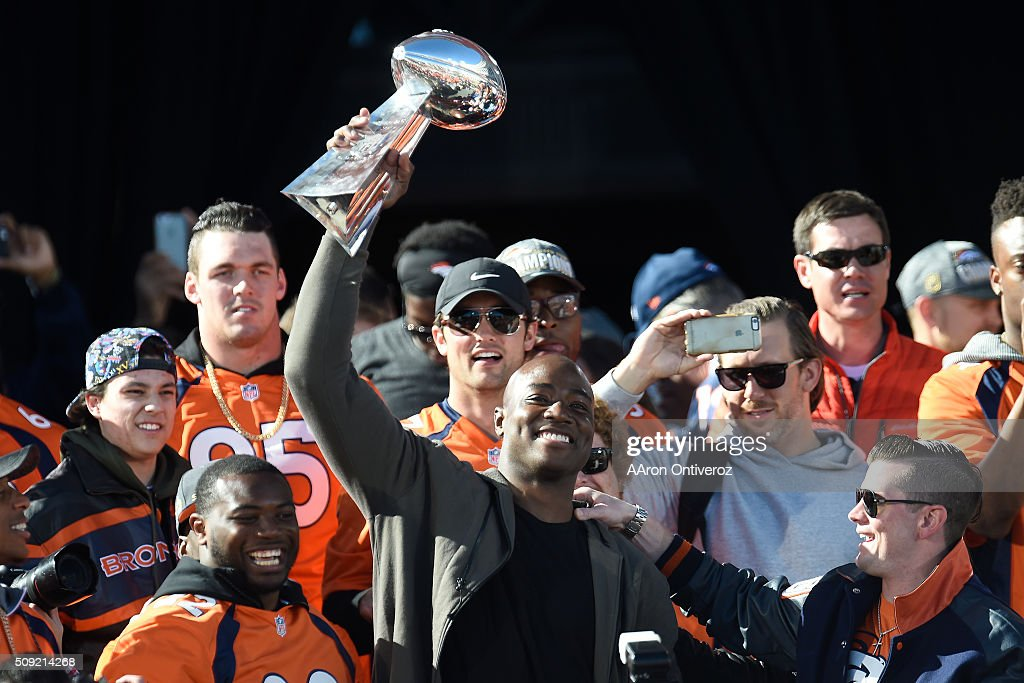 Demarcus Ware hoists the Lombardi Trophy during the Denver Broncos Super Bowl championship celebration and parade on Tuesday February 9, 2016.