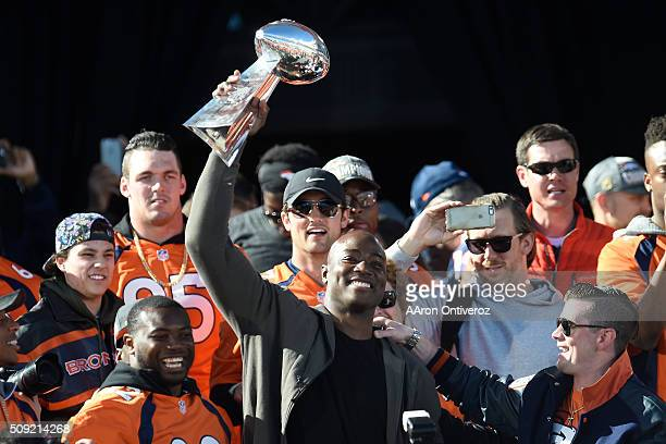 Demarcus Ware hoists the Lombardi Trophy during the Denver Broncos Super Bowl championship celebration and parade on Tuesday February 9 2016